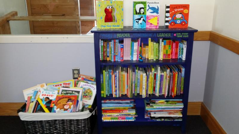 Bookshelf and books provided by GS Troop 2208 to GRF.